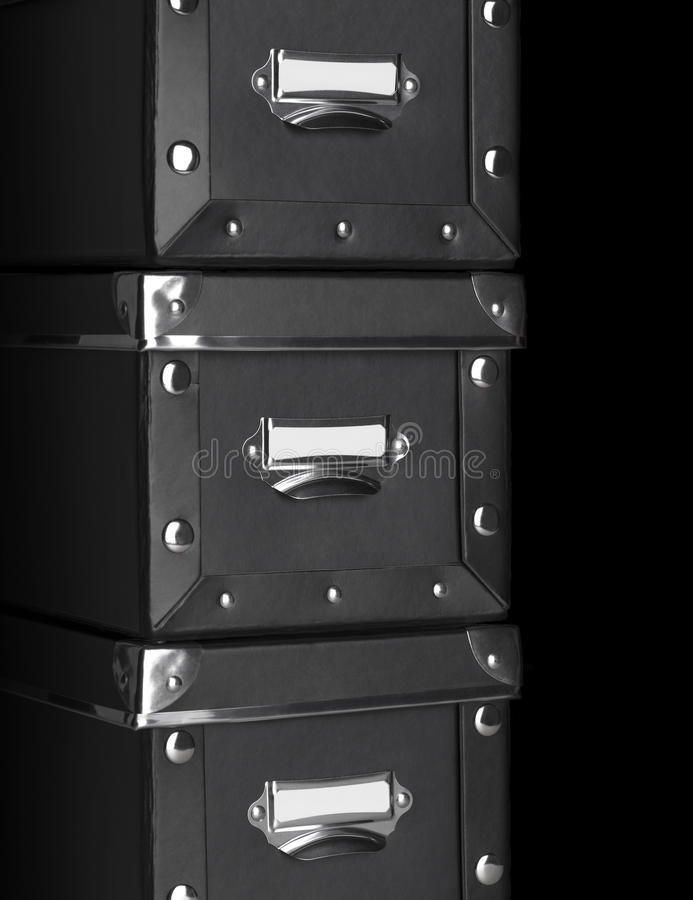 Storage boxes with metal corners. Close-up of a black storage boxes with metal corners royalty free stock photos
