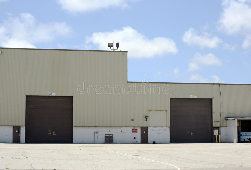 Storage building. Commercial storage building with beautiful sky background royalty free stock photography