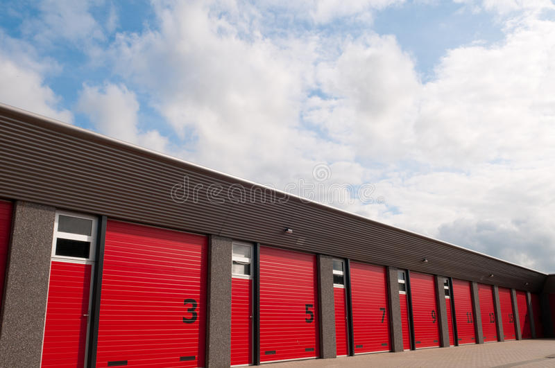 Storage building with red doors. Storage building with red numbered doors stock image