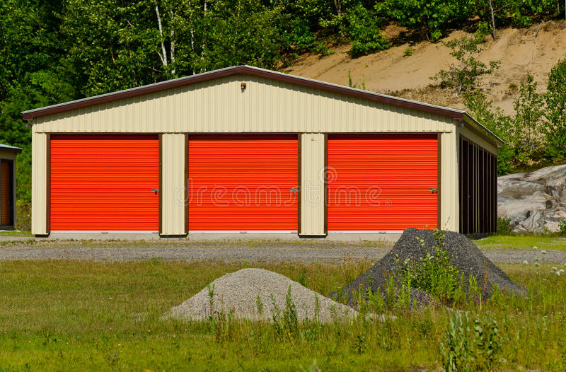 Storage building. With three orange doors royalty free stock photo
