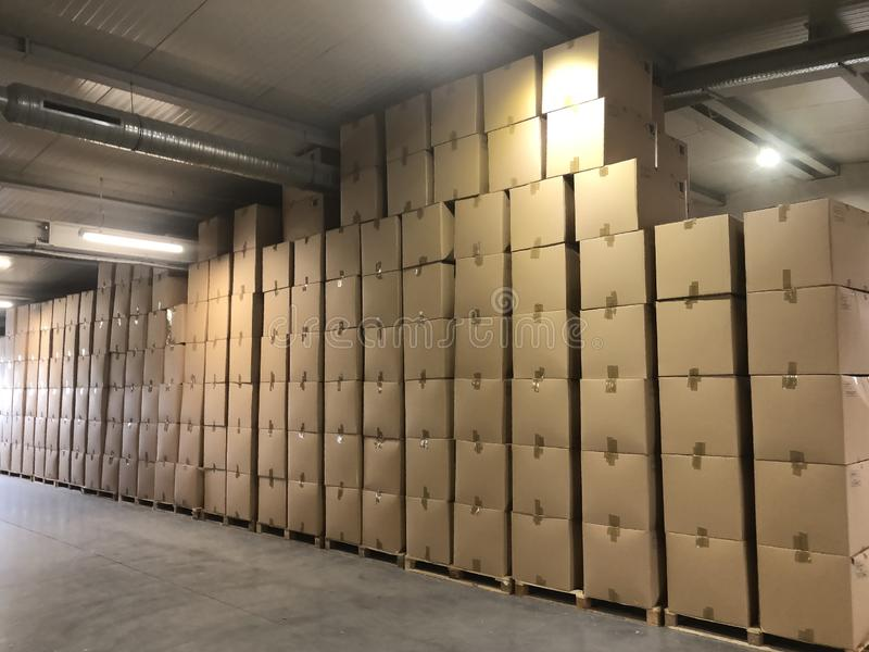Storage of cardboard boxes on production stock image