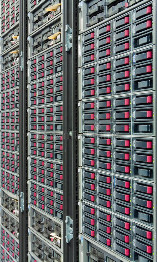 Storage cloud. A farm of hard drives - part of a datacenter, used as a storage cloud royalty free stock photos