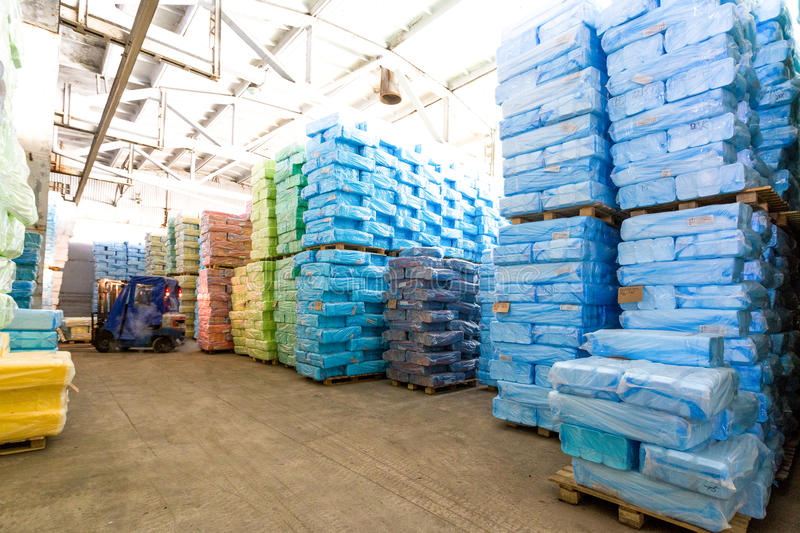 Storage at factory with wrapped in plastic boxes. Storage at factory with wrapped in color plastic boxes royalty free stock photo