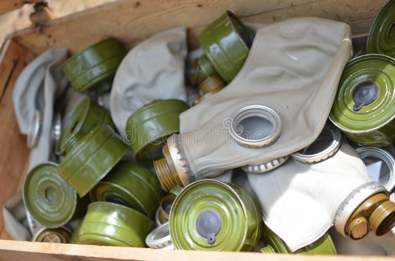 Storage of old gas masks stock image