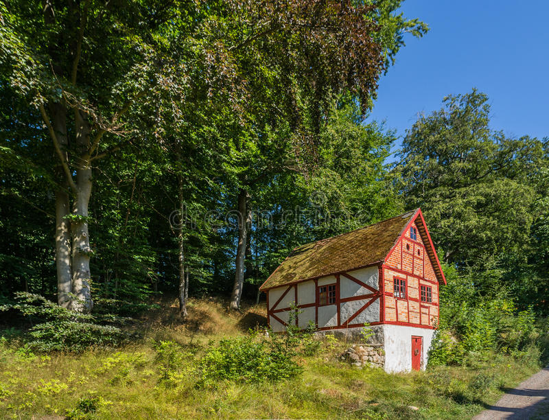 Storage. Old half-timbered building founded on a slope stock photo