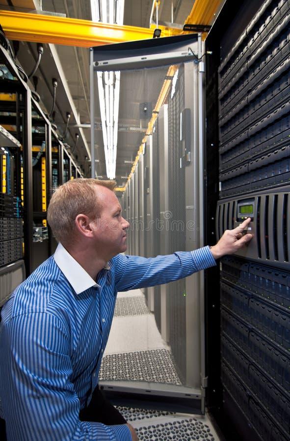 Storage Server SAN/NAS. Technician working on a large scale Storage server (SAN/NAS stock photo
