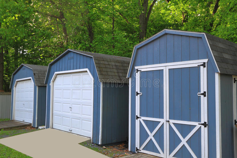 Storage Sheds. Three Storage Sheds in wood stock photography