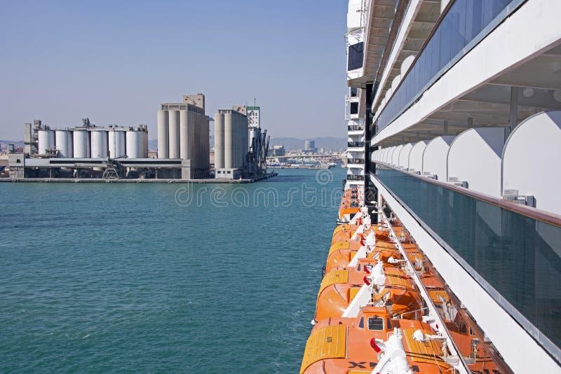 Storage tanks with cruiseship detail royalty free stock photos