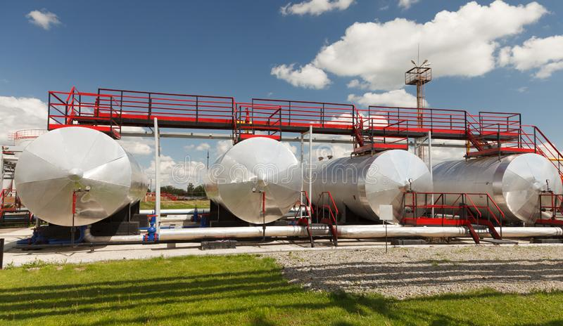 Storage Tanks for petroleum products at the refinery. Oil industry. Oil Storage Tanks for petroleum products at the refinery royalty free stock images