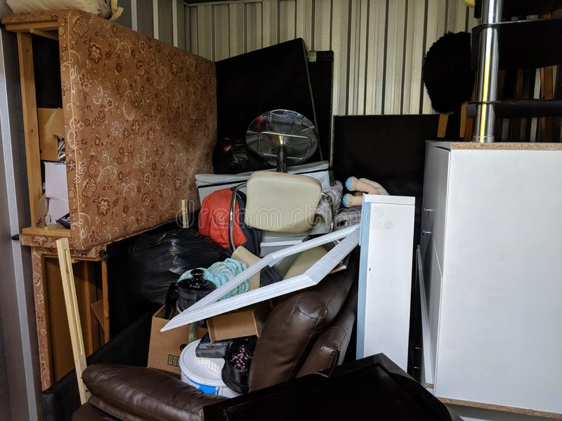A storage unit full of stored household junk items stock photo