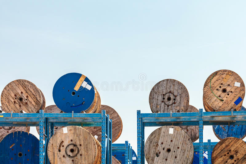 Storage of wooden cable spools. Outside storage of wooden cable spools royalty free stock photography