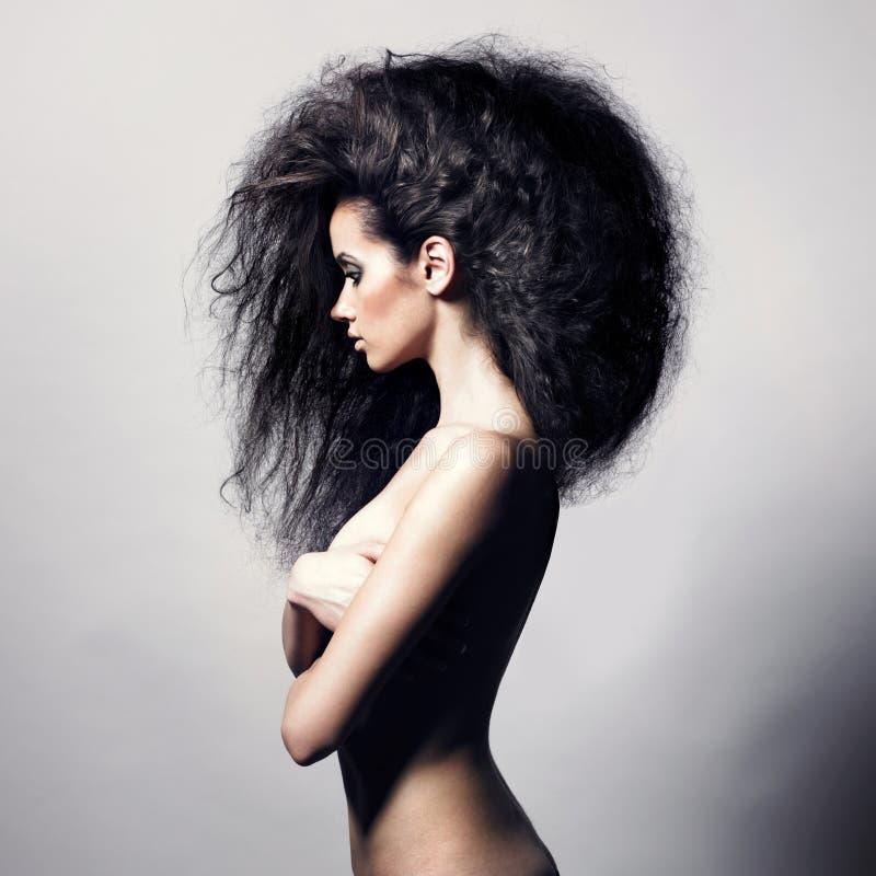 storartad kvinna för härligt hår royaltyfria bilder