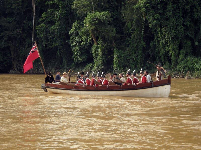Storbritannien flottor i fartyg på den leriga floden royaltyfria bilder
