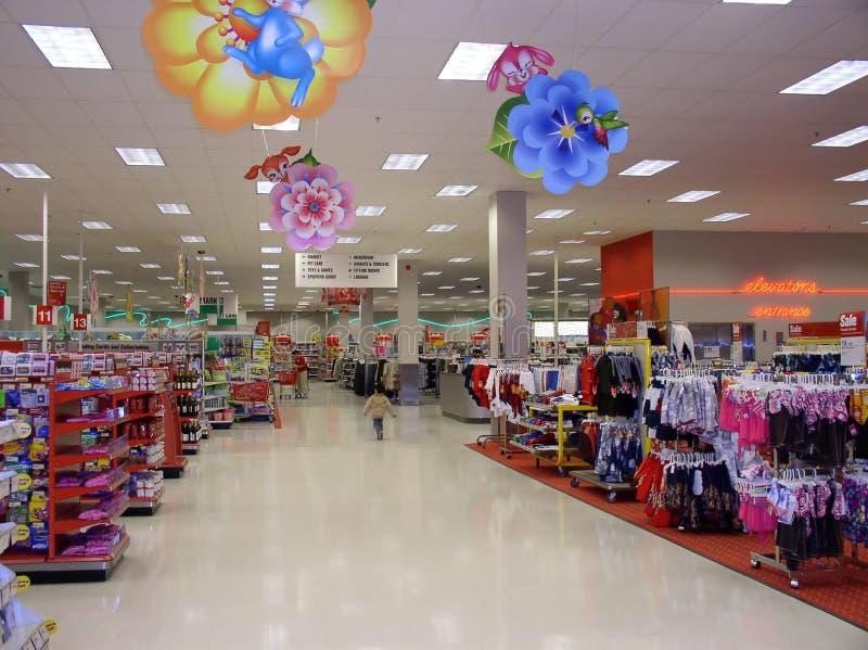 Store. A boy is walking in a store in america