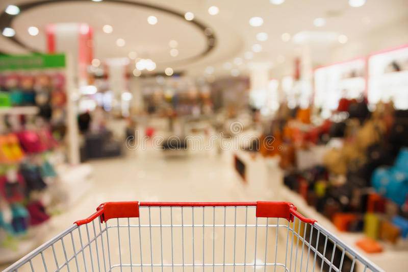 Store blur background with bokeh. Shopping cart with shopping mall store blur background with bokeh royalty free stock photography