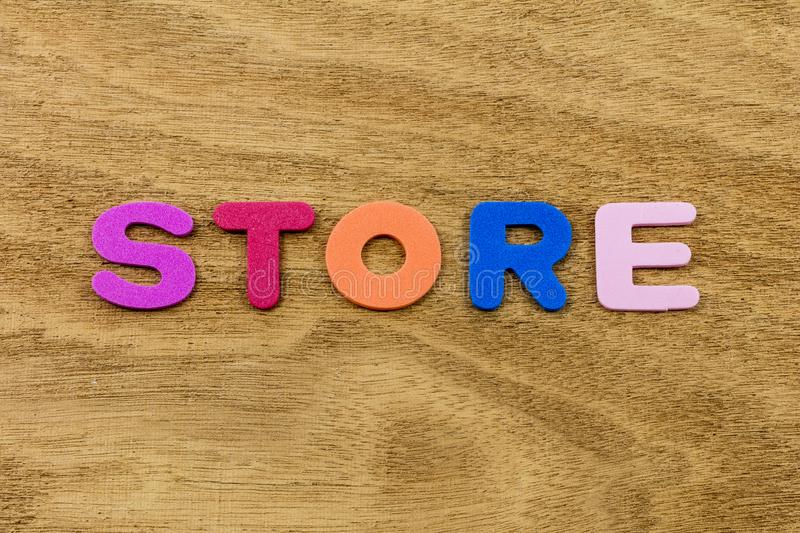 Store children letters plastic keep display hours toys building. School learning storage business spelling spell color background child preschool royalty free stock photos