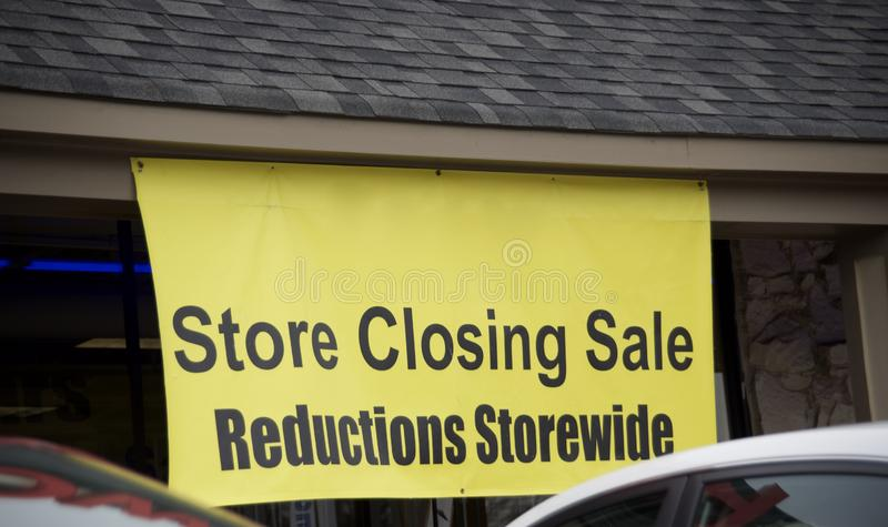 Store Closing Sale Reductions Storewide. A retail good store or franchise that is pending bankruptcy and is liquidating it assets in order to pay off debtors royalty free stock photos