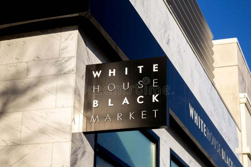 White House Black Market store sign. A store front sign for the upscale casual women`s apparel retailer known as White House Black Market stock image