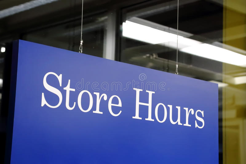 Store hours sign. In the shop stock photos