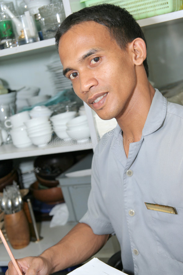 Store keeper. Storekeeper at work in store stock image