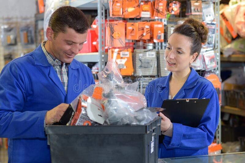 Store manager with warehouseman checking goods reception stock images