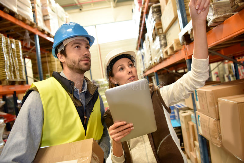Store manager with warehouseman working royalty free stock image
