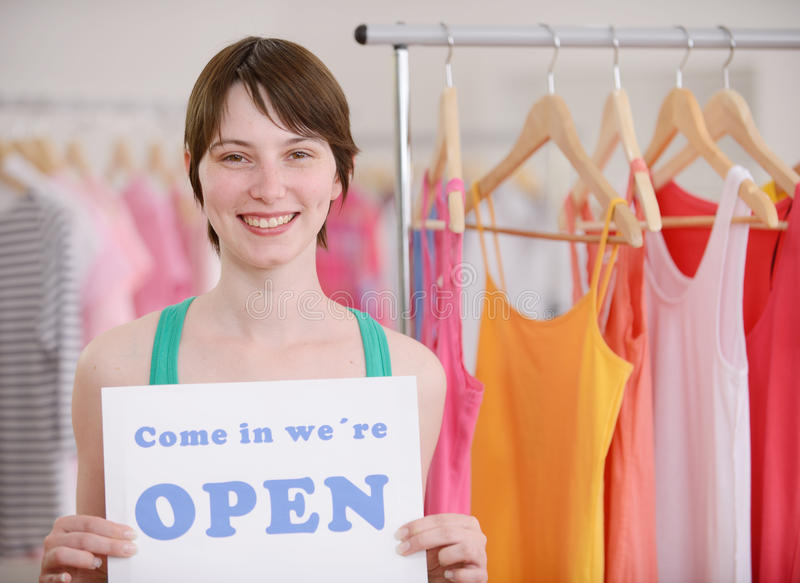 Store owner holding open sign. Small business: Store owner holding open sign stock photo