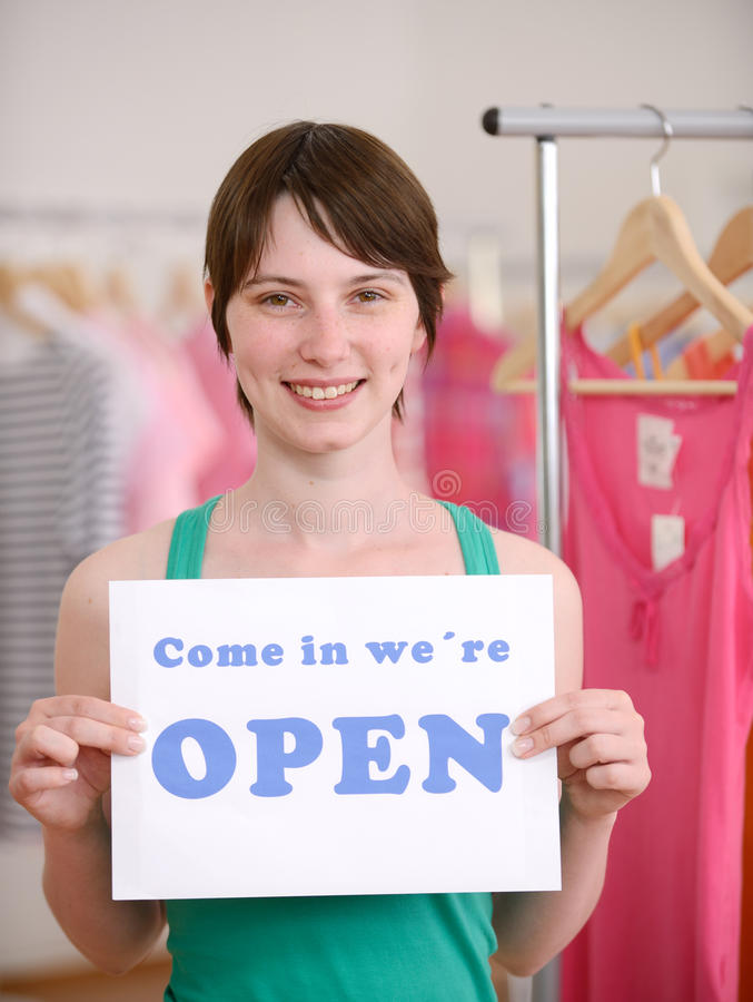 Store owner holding open sign. Small business: Store owner holding open sign stock image