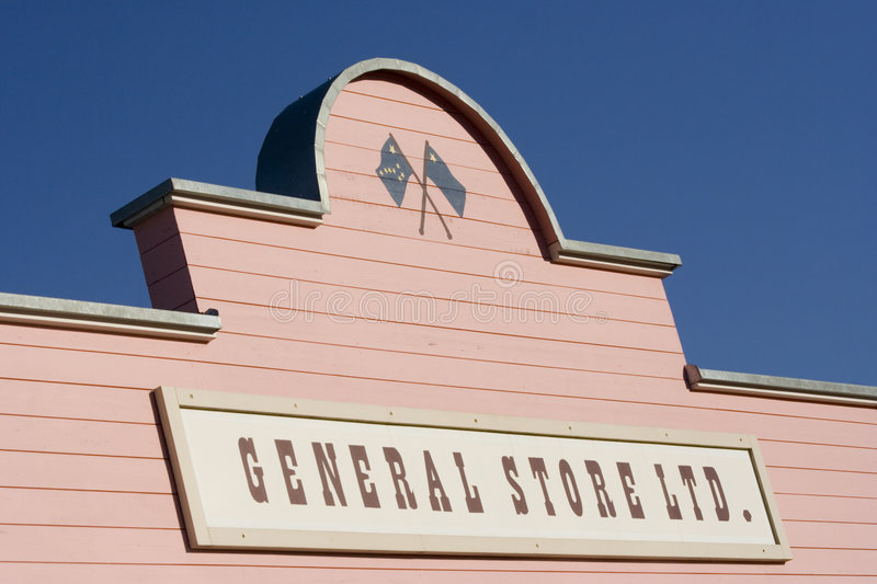 Store sign. Commercial sign on a pink house - adobe RGB royalty free stock image