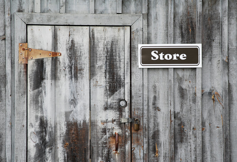 Store Sign On Grey Wall. Store Sign On Grey Wooden Wall stock photography