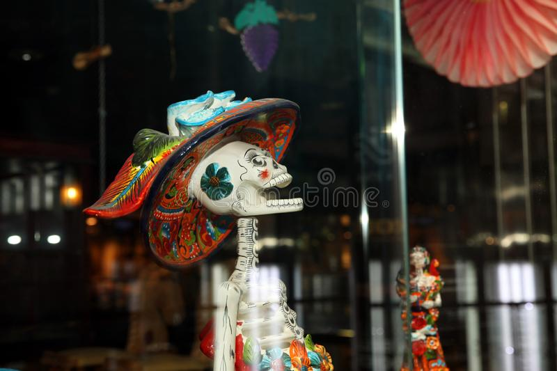 Storefront, Mexican sculpture funny female skull closeup royalty free stock photography