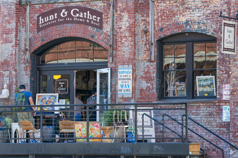 Storefront in old Warehouse Building in Portland, Oregon. Portland, Oregon, USA - September 20, 2014: A storefront with a variety of things for sale at it`s stock photos