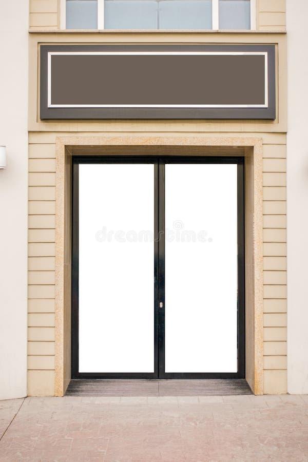 storefront Raillez vers le haut de la porte en verre vide et de l'enseigne vide photo libre de droits