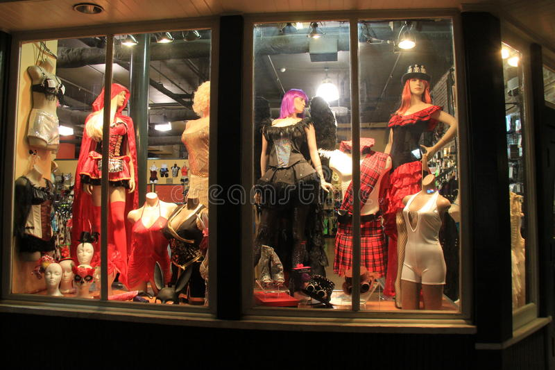 Storefront window with strange, but interesting fashion, New Orleans, 2016. Brightly lit storefront windows with mannequins dressed and posed in strange, but stock image
