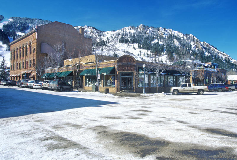 Storefronts and ski slope in the town of Aspen, Colorado royalty free stock photo