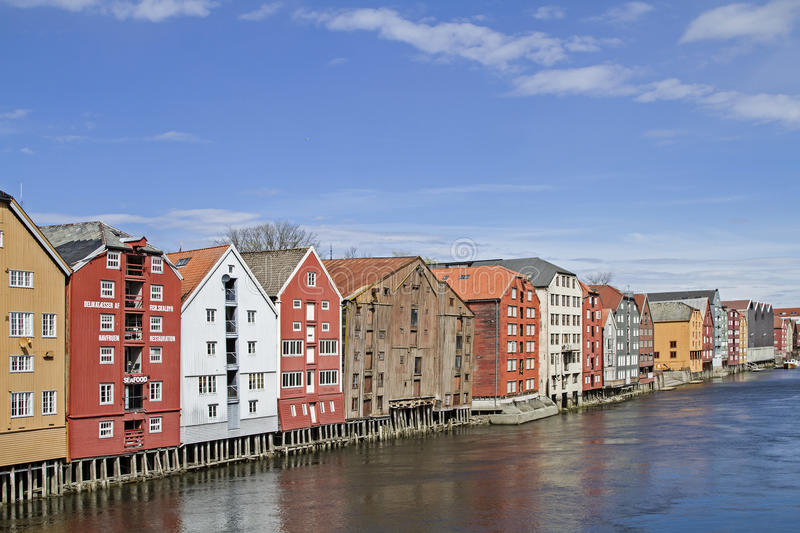 Storehouses in Trondheim. Old stately warehouses in Trondheim line the banks of the river royalty free stock images