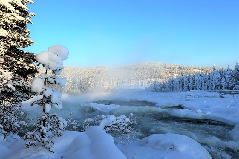Storforsen in a fabulous winter landscape. Storforsen is Europe`s largest unregulated rapids, where the total length of the entire rapids, from start to finish stock photography