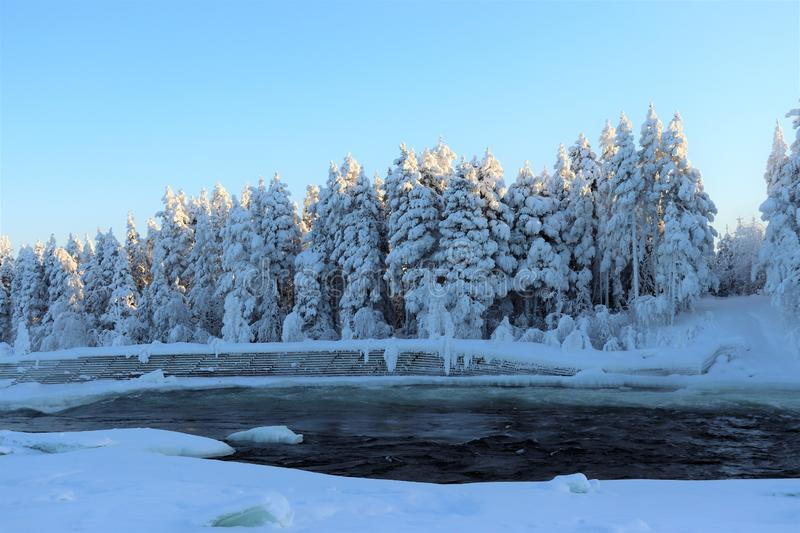 Storforsen in a fabulous winter landscape. Storforsen is Europe`s largest unregulated rapids, where the total length of the entire rapids, from start to finish stock images