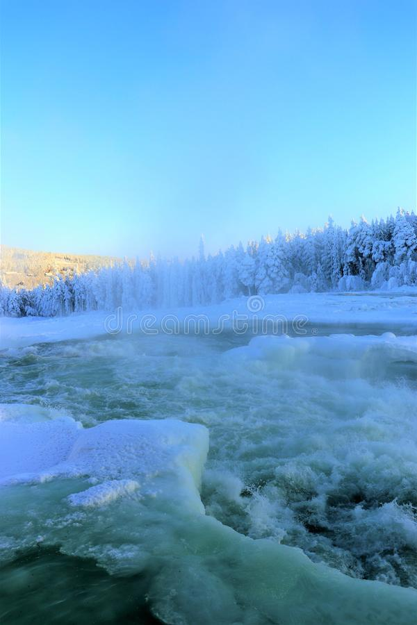 Storforsen in a fabulous winter landscape. Storforsen is Europe`s largest unregulated rapids, where the total length of the entire rapids, from start to finish stock photos