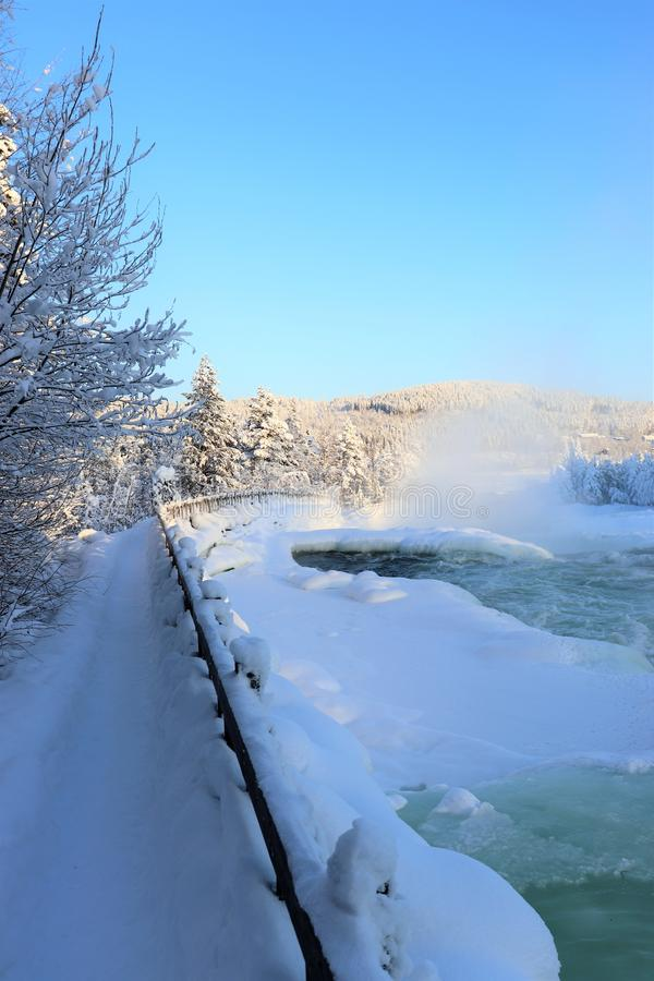 Storforsen in a fabulous winter landscape. Storforsen is Europe`s largest unregulated rapids, where the total length of the entire rapids, from start to finish stock image