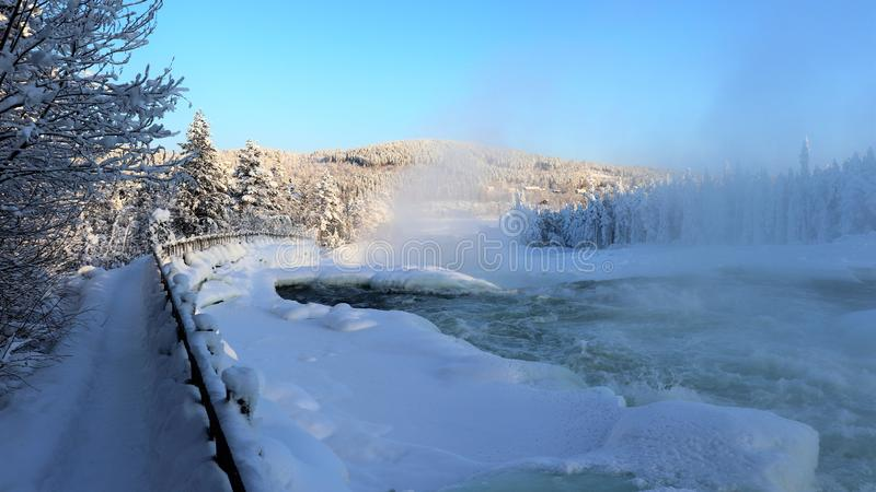 Storforsen in a fabulous winter landscape. Storforsen is Europe`s largest unregulated rapids, where the total length of the entire rapids, from start to finish royalty free stock photography