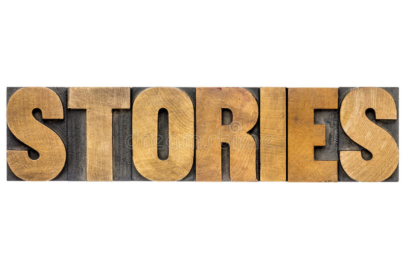 Stories word in letterpress wood type. Stories word - isolated text in letterpress wood type printing blogs royalty free stock images