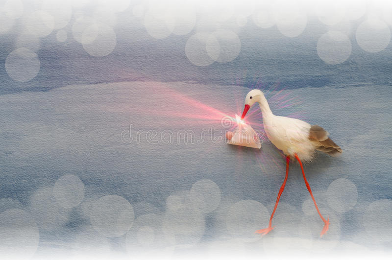 Stork delivering baby stock photography