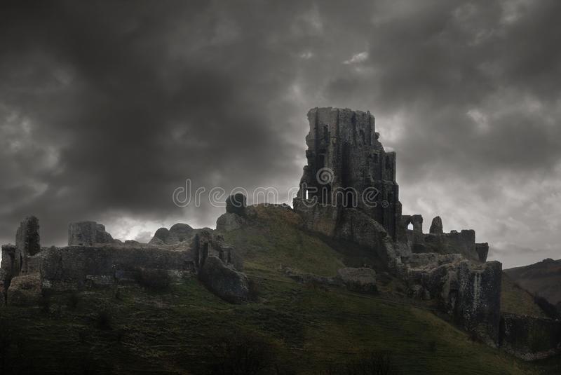 Storm above castle ruins stock image