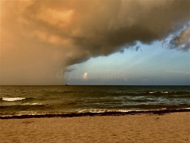 The storm Approaches the Moored Vessel at Sea royalty free stock photos