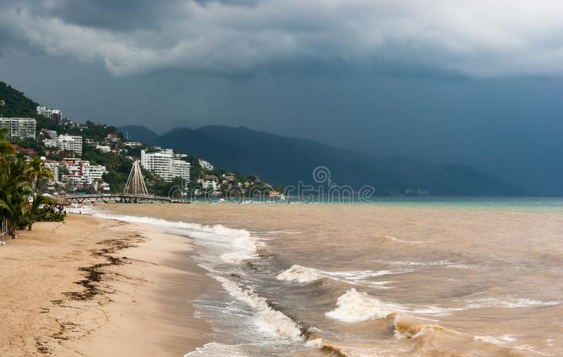Storm approaching. Dark storm clouds and heavy rain approaching Puerto Vallarta from the south royalty free stock photos