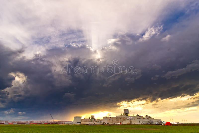 Storm approaching a Mine. Storm approaching a Potash Mine located southwest of Saskatoon, Canada royalty free stock photos