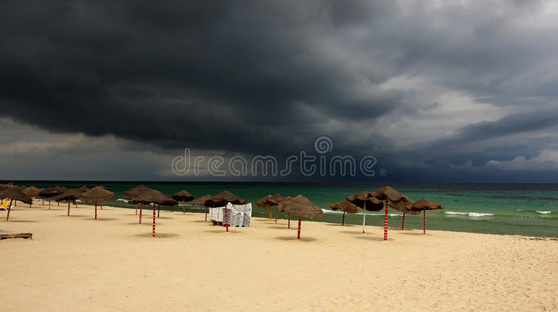 Storm approaching over a tropical beach royalty free stock image