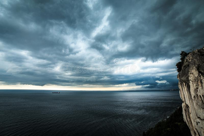 Storm is coming in the gulf of Trieste. Storm approaching the sea in the gulf of Trieste royalty free stock photography