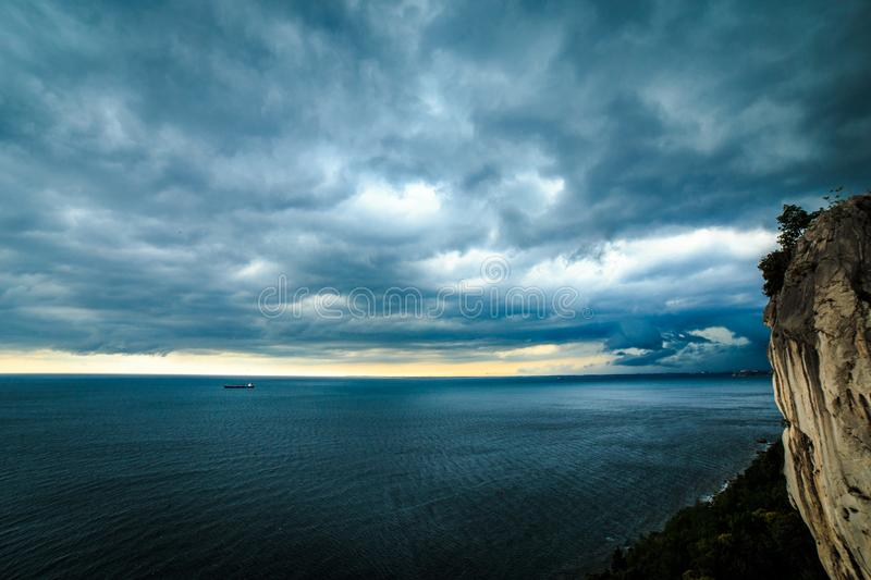 Storm is coming in the gulf of Trieste. Storm approaching the sea in the gulf of Trieste royalty free stock photo